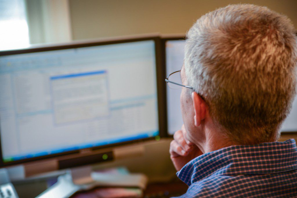 Cincinnati financial planning expert looking at computer screen